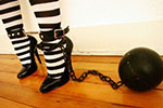 Hard to be a prisoner in high heels, and harder with a metal ball attached to your ankle (plus gagged and collared)