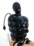 Mistress Sandra got Anna Vorski caught in the Rubber Inflatable jacket then head-trapped in the Triple Layers latex mask.