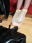 Slave enduring the foot fetish mask (and full fashioned nylons)!